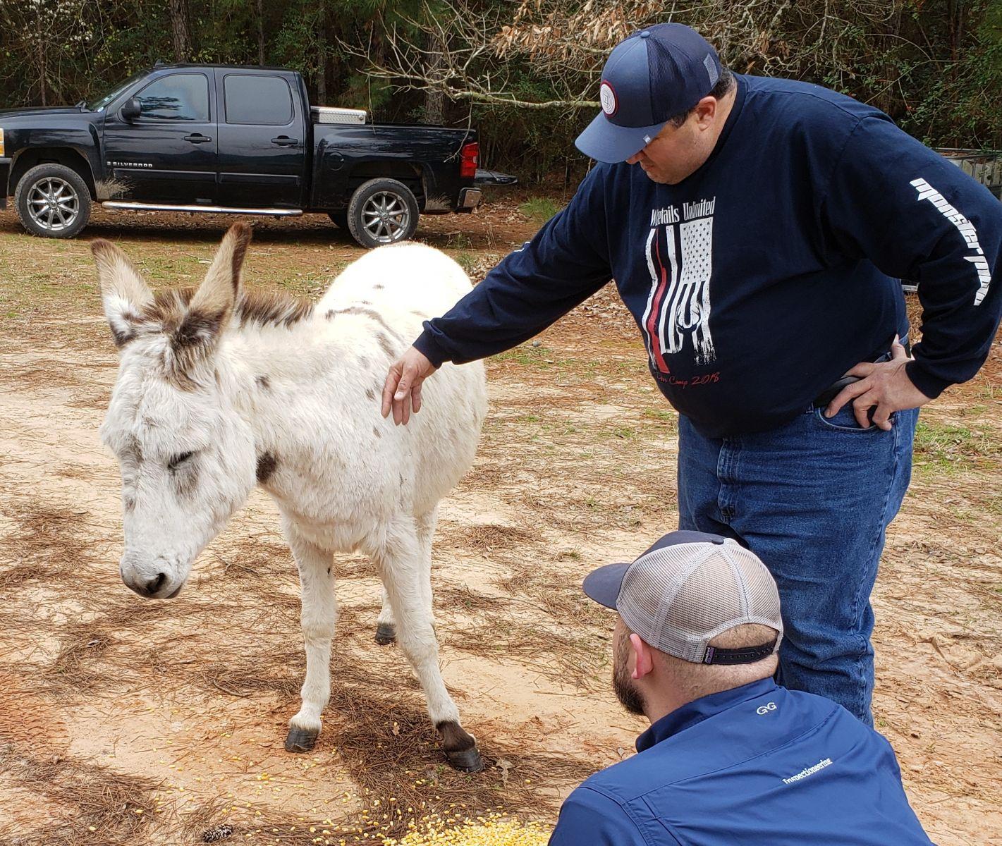 James Cesarini, Tyler Alvarado, and Milkshake, the donkey.